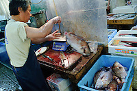 Workers in the market, Tsukiji fish market, Tokyo, Japan, January 9 2007.