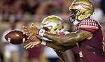 Florida State quarterbacks Deondre Francois takes a snap against Samford in the first half of an NCAA college football game in Tallahassee, Fla.,Saturday, Sept. 8, 2018.  Florida State defeated Samford 36 to 26.