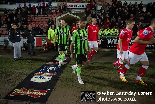 Wrexham 1 Brighton & Hove Albion 1, 18/01/2012. Racecourse Ground, FA Cup 3rd Round Replay. The teams emerging from the tunnel at the Racecourse Ground, before Wrexham (in red) hosted Brighton and Hove Albion in an FA Cup third round replay, played following the teams one-all draw in the first match. The replay was won by Brighton, 5-4 on penalty kicks after the match had ended in a one-all draw after extra time, watch by a crowd of 8316. The visitors played in the Championship, three leagues above their rivals from Wales, who were top of the Conference at the time of the match. Photo by Colin McPherson.