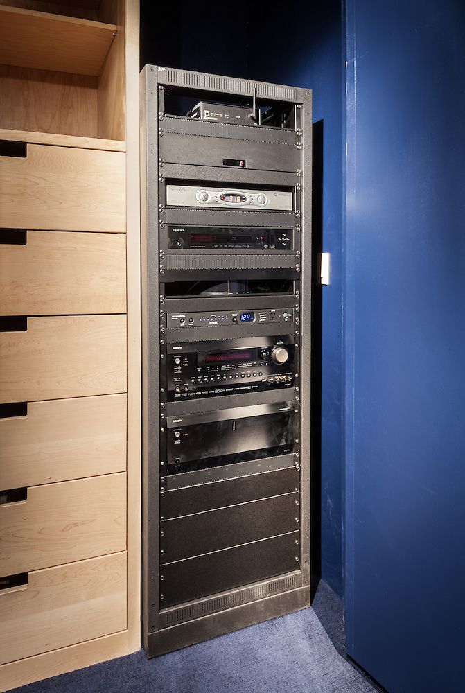 Every custom home theater needs control. This theater's equipment rack is concealed in a closet for a clutter-free space.