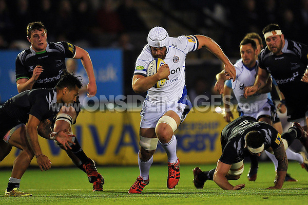 Dave Attwood of Bath Rugby takes on the Newcastle Falcons defence. Aviva Premiership match, between Newcastle Falcons and Bath Rugby on April 10, 2015 at Kingston Park in Newcastle upon Tyne, England. Photo by: Patrick Khachfe / Onside Images