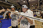 27 APR 2014: Sean Pegterson (L) and Ryan Malone (R) cut down the net  during the Division III Men's Volleyball Championship held at the Kennedy Sports Center in Huntingdon, PA. Springfield defeated Juniata 3-0 to win the national title.  Mark Selders/NCAA Photos