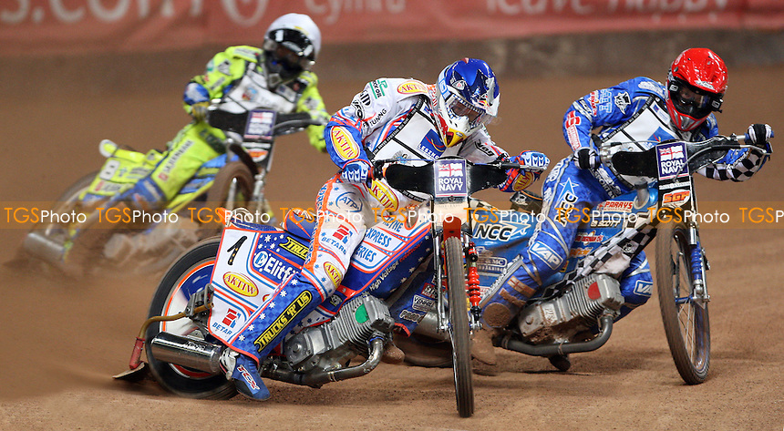 Heat 3: Jason Crump (blue), Fredrik Lindgren (red) and Kenneth Bjerre (white) - British Speedway Grand Prix at the Millennium Stadium, Cardiff - 10/07/10 - MANDATORY CREDIT: Rob Newell/TGSPHOTO - Self billing applies where appropriate - 0845 094 6026 - contact@tgsphoto.co.uk - NO UNPAID USE.