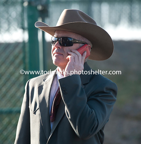 Donny Von Hemel takes a phone call just before leaving the Aqueduct stable area to accompany Caleb's Posse to the paddock for the Tom Fool on March 3.