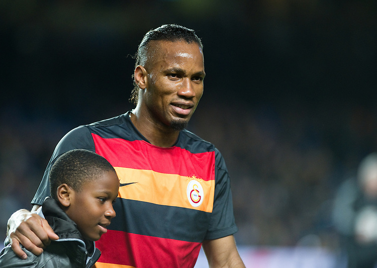 Galatasaray's Didier Drogba and the pre match presentation at Stamford Bridge<br /> <br /> Photo by Ashley Western/CameraSport<br /> <br /> Football - UEFA Champions League First Knockout Round 2nd Leg - Chelsea v Galatasaray - Tuesday 18th March 2014 - Stamford Bridge - London<br />  <br /> &copy; CameraSport - 43 Linden Ave. Countesthorpe. Leicester. England. LE8 5PG - Tel: +44 (0) 116 277 4147 - admin@camerasport.com - www.camerasport.com