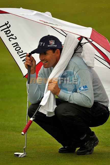 Padraig Harrington lines up his putt the 12th green during Round1 of the 3 Irish Open on 14th May 2009 (Photo by Eoin Clarke/GOLFFILE)