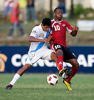 Jose Avila (20) of Guatemala fights for the ball with Jomal Williams (20) of Trinidad & Tobago  during the group stage of the CONCACAF Men's Under 17 Championship at Jarrett Park in Montego Bay, Jamaica. Trinidad & Tobago defeated Guatemala, 1-0.