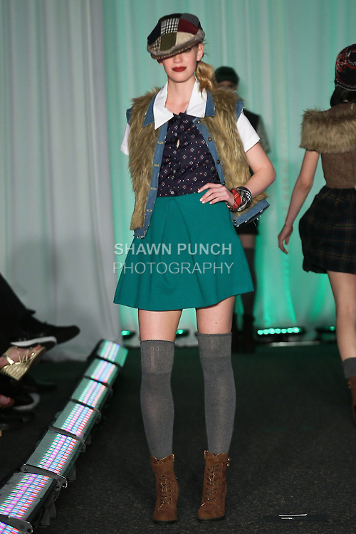 Model walks runway in an outfit by Naomi S. Tilewick, for the Syracuse University, College of Visual and Peforming Arts 2011 Fashion Show Gala.