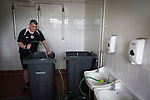 A member of the backroom staff fills bins for ice baths in the away dressing room at Borough Briggs, home to Elgin City, on the day they played SPFL2 newcomers Edinburgh City. Elgin City were a former Highland League club who were elected to the Scottish League in 2000, whereas Edinburgh City became the first club to gain promotion to the League by winning the Lowland League title and subsequent play-off matches in 2015-16. This match, Edinburgh City's first away Scottish League match since 1949, ended in a 3-0 defeat, watched by a crowd of 610.