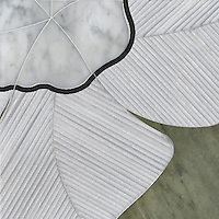 Raku Flower Large, a stone water jet mosaic, shown in, Carrara, Thassos, Negro Marquina, and Verde Luna, is part of the Ann Sacks Beau Monde collection sold exclusively at www.annsacks.com