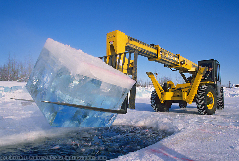 Zoom boom harvests large blocks of ice from a Fairbanks pond. Blocks, cut by chainsaws are used by sculptors in the World Ice Art Championships held each march in Fairbanks