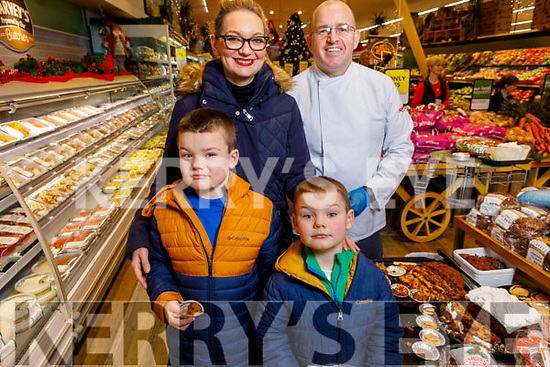 Breda, Adam and Daniel Furlong with James Brosnan at the Garveys Supervalu Castleisland's Food Fair on Tuesday.