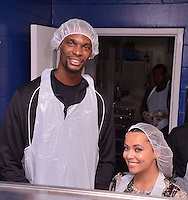 MIAMI, FL - NOVEMBER 20: Chris Bosh and Team Tomorrow Inc. team up for the 2nd year with Chapman Partnership to feed the local families of Miami this Thanksgiving on November 20, 2012 in Miami, Florida. © MPI10/MediaPunch Inc