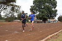 Ioannis Magkriotellis, left, a Greek marathon runner training in Iten with Kenyan athlete Johanna Kariankei. Magkriotellis is hoping to improve his time  enough through high-altitude training to qualify for  the Olympics on Greece's team. International athletes have flocked to Iten hoping to gain  advantage from training with the world's fastest  distance runners at high altitude.