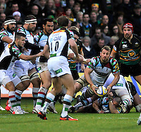 Northampton, England. Chris Robshaw (Captain) of Harlequins clears the ball during the Aviva Premiership match between Northampton Saints and Harlequins at Franklin's Gardens on December 22. 2012 in Northampton, England.