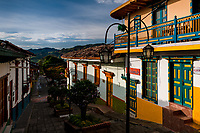 Colorfully painted wooden balconies and windows are seen at a colonial house during the sunrise in Jericó, a village in the coffee region (Zona cafetera) of Colombia, 24 April 2018.