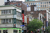Buildings along a street in downtown Montreal in summer