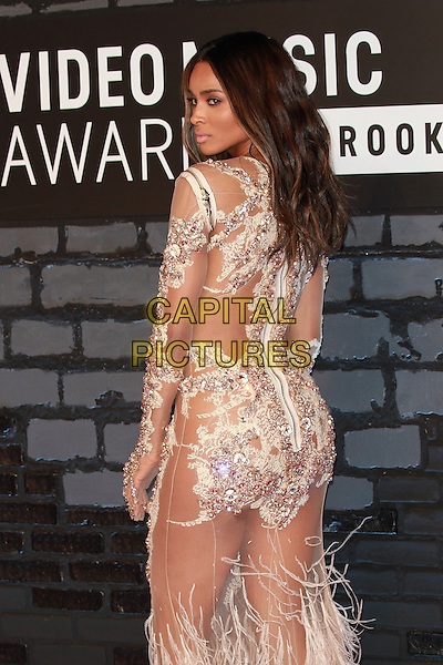 Ciara (Ciara Princess Harris)<br /> 2013 MTV Video Music Awards held at The Barclays Center, Brooklyn, New York, USA.<br /> August 25th, 2013<br /> half length white silver sheer feather sheer embellished jewel encrusted see through thru dress  back behind rear looking over shoulder VMA VMAS<br /> CAP/ADM/MPI/C99<br /> &copy;C99/MPI/AdMedia/Capital Pictures