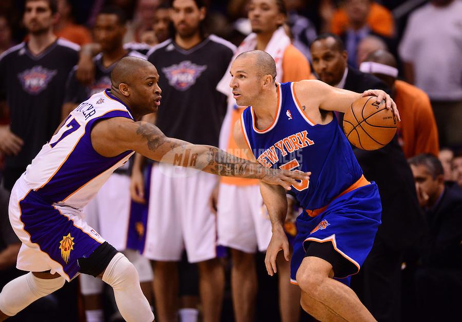Dec. 26, 2012; Phoenix, AZ, USA: New York Knicks guard Jason Kidd (right) controls the ball against Phoenix Suns forward P.J. Tucker at the US Airways Center. Mandatory Credit: Mark J. Rebilas-USA TODAY Sports