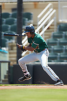 Tristan Pompey (22) of the Greensboro Grasshoppers snaps his bat in two as he follows through on his swing against the Kannapolis Intimidators at Kannapolis Intimidators Stadium on August 5, 2018 in Kannapolis, North Carolina. The Grasshoppers defeated the Intimidators 2-1 in game one of a double-header.  (Brian Westerholt/Four Seam Images)