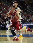 Davidson's Brian Sullivan (3) moves to the basket past  Iowa's Josh Oglesby (2) during 2015 NCAA Division I Men's Basketball Championship March 20, 2015 at the Key Arena in Seattle, Washington.  Iowa beat Davidson 83-52.   ©2015. Jim Bryant Photo. ALL RIGHTS RESERVED.