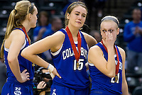 Columbus North forward Elle Williams (15) and guard Amy Weisner (21) stand on the stage after receiving runners-up medals following a 68-48 loss to Penn in the IHSAA Class 4A Girls Basketball State Championship Game on Saturday, Feb. 27, 2016, at Bankers Life Fieldhouse in Indianapolis.