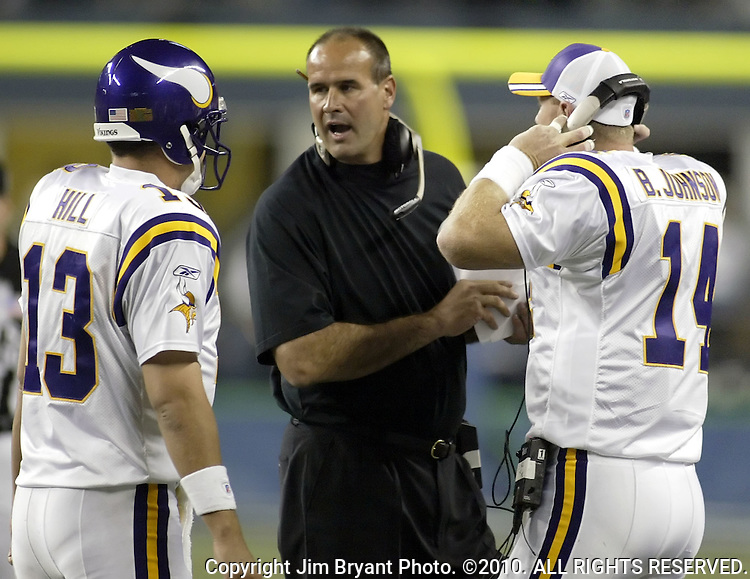 Minnesota Vikings coach Mike Tice ,center, talks to his two quarterbacks Shaun Hill ,left, and Brad Johnson, right, in their game against the Seattle Seahawks during the fourth quarter Friday, Sept. 2, 2005  at QWEST Field in Seattle. Jim Bryant Photo. ©2010. All Rights Reserved.