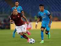 AS Roma's Radja Nainggolan  and Barcellona's Neymar during the Champions League Group E soccer match   at the Olympic Stadium in Rome September 16, 2015