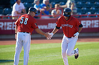 Erie SeaWolves manager Mike Rabelo (58) congratulates Daniel Pinero (34) as he rounds the bases after hitting a home run during an Eastern League game against the Richmond Flying Squirrels on August 28, 2019 at UPMC Park in Erie, Pennsylvania.  Richmond defeated Erie 6-4 in the first game of a doubleheader.  (Mike Janes/Four Seam Images)