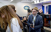 Reporters including Glenn Thrush, chief White House political correspondent for the The New York Times stand in the James S. Brady Press Briefing Room of the White House after being excluded from the meeting  on February 24, 2017 in Washington, DC. CNN, the New York Times and other news organizations were blocked Friday from a White House press briefing.<br /> Credit: Olivier Douliery / Pool via CNP