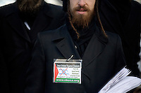 Orthodox Jewish members of Neturei Karta International: Jews United Against Israel stand outside a Ron Paul town hall meeting and rally at the Church Landing at Mills Falls hotel in Meredith, New Hampshire, on Jan. 8, 2012. Paul is seeking the 2012 Republican presidential nomination.