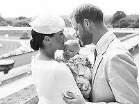 06 July 2019 - Windsor, UK - This official christening photograph released by the Duke and Duchess of Sussex shows the Duke and Duchess with their son, Archie Harrison Mountbatten-Windsor at Windsor Castle in Berkshire with with the Rose Garden in the background. Photo Credit: ALPR/AdMedia