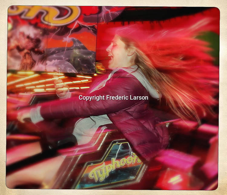 A girl enjoys a roller coaster ride at the Mill Valley carnival during Memorial Day Weekend.