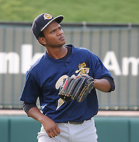Infielder Jose Mojica (13) of the Charleston RiverDogs, Class A affiliate of the New York Yankees, prior to a game against the Greenville Drive on July 31, 2011, at Fluor Field at the West End in Greenville, South Carolina. (Tom Priddy/Four Seam Images)