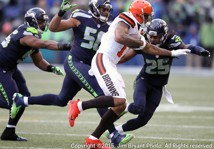 Seattle Seahawks linebacker K.J. Wright (50) and cornerback Richard Sherman (25) boxes in Cleveland Browns wide receiver Terrelle Pryor (17) at CenturyLink Field in Seattle, Washington on December 20, 2015. The Seahawks clinched their fourth straight playoff berth in four seasons by beating the Browns 30-13.  ©2015. Jim Bryant Photo. All Rights Reserved.