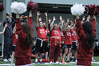 STAFF PHOTO SAMANTHA BAKER &bull; @NWASAMANTHA<br /> Canyon Sowers, middle left, and Special Olympic athletes call the Hogs Sunday, April 6, 2014, at the Walker Family Indoor Football Center in Fayetteville during a Unified Field Day. More than 20 Special Olympics Arkansas athletes and more than 20 Arkansas student-athletes came together for the event to celebrate athletic abilities and leadership. Games included flag football, volleyball and bocce ball.