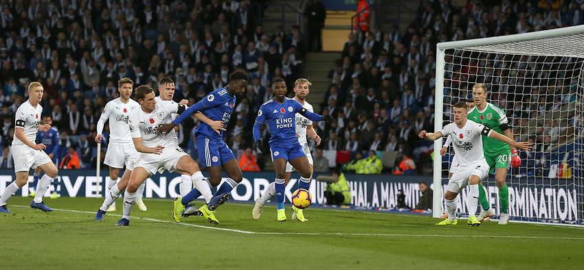 Leicester City's Wilfred Ndidi is tackled by Burnley's Chris Wood<br /> <br /> Photographer Stephen White/CameraSport<br /> <br /> The Premier League - Saturday 10th November 2018 - Leicester City v Burnley - King Power Stadium - Leicester<br /> <br /> World Copyright © 2018 CameraSport. All rights reserved. 43 Linden Ave. Countesthorpe. Leicester. England. LE8 5PG - Tel: +44 (0) 116 277 4147 - admin@camerasport.com - www.camerasport.com