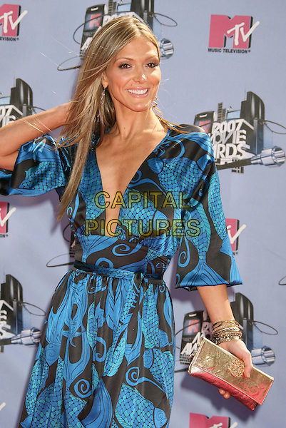 DEBBIE MATENOPOULOS.2007 MTV Movie Awards held at the Gibson Amphitheater, Universal City, California, USA..June 3rd, 2007.half length black blue print pattern maxi dress gold clutch purse.CAP/ADM/RE.©Russ Elliot/AdMedia/Capital Pictures *** Local Caption *** ...