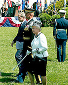 Washington, D.C. - May 7, 2007 -- United States President George W. Bush and Her Majesty Queen Elizabeth II of Great Britain review the troops during an Arrival Ceremony on the South Lawn of the White House in Washington, D.C. on Monday, May 7, 2007.  .Credit: Ron Sachs / CNP