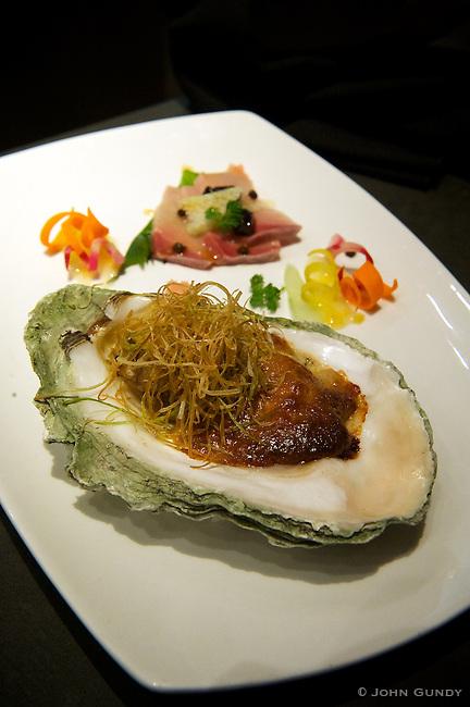 Chef Daisuke Izutsu, Kaiseki Sakura. Beach Angelo Oyster Miso Gratine flavoured with Sesami-Yuzu Kuzu and Yellow TailCarpaccio in Yuzu Dressing.