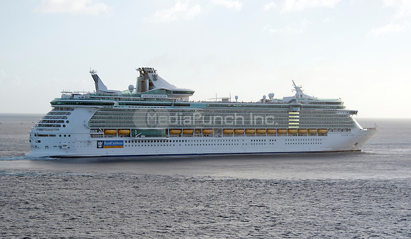 The Royal Caribbean Freedom of the Seas, which carries 4,515 passengers and 1,360 crew, and the Celebrity Reflection, which carries 3,609 passengers and 1271 crew, departs the harbor of George Town, Grand Cayman in the Cayman Islands on Tuesday, December 20, 2016.  <br /> Credit: Ron Sachs / CNP /MediaPunch
