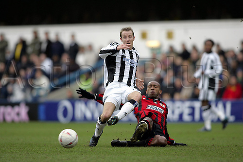 9 January 2005:  Newcastle midfielder Lee Bowyer is tackled by Davis Haule during the F.A Cup third round tie between Yeading and Newcastle. Newcastle won 2-0 at Loftus Road, London Photo: Glyn Kirk/Actionplus....050109 player soccer football .