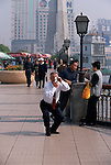 Man photographing on the Bund; tourist attraction; camera man; morning; Shanghai, China, Asia; 041503