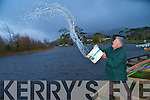 Gerald O'Connor, Inchicullane, Kilcummin, empties water from his flooded boat at the Killarney Golf and fishing club on Saturday....