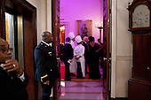 White House and Residence staff look into the State Dining Room during the State Dinner, Wednesday, January 19, 2011. During the dinner, First Lady Michelle Obama introduced White House Executive Chef Cris Comerford and Pastry Chef Bill Yossis to thank them for preparing the meal. .Mandatory Credit: Samantha Appleton - White House via CNP