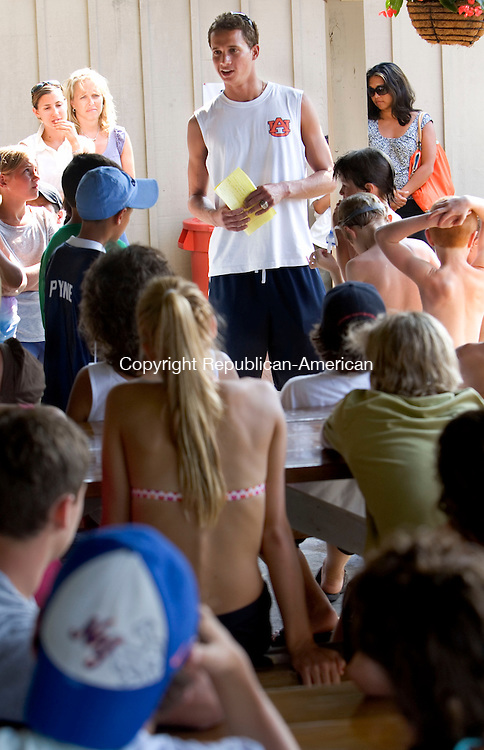WALLINGFORD, CT- 01 JULY 2008- 070108JT10-<br /> Former Cheshire student Dan Mazzaferro, now a student at Auburn University, speaks to young swimmers on Tuesday at the Farms Country Club in Wallingford. Mazzaferro spoke about his recent experience in the Olympic trials, in which he placed 7th, and missed being selected for the U. S. Olympic Diving Team selection camp by four-tenths of a point. To view a photo gallery of the event, visit www.rep-am.com<br /> Josalee Thrift / Republican-American