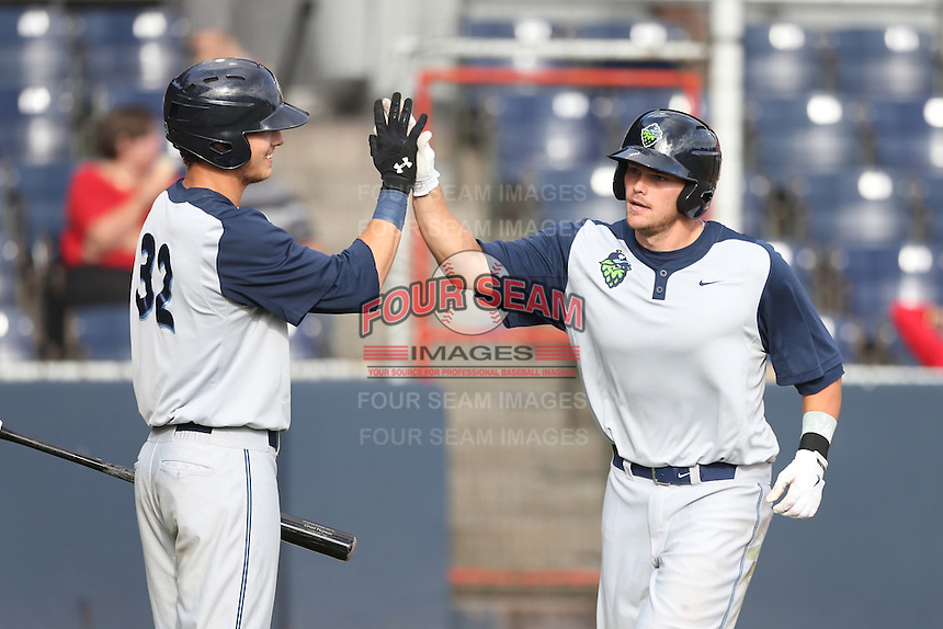 Taylor Ard #38 of the Hillsboro Hops is greeted by teammate Grant Heyman #32 after hitting a home run during a game against the Vancouver Canadians at Nat Bailey Stadium on July 24, 2014 in Vancouver, British Columbia. Hillsboro defeated Vancouver, 7-3. (Larry Goren/Four Seam Images)