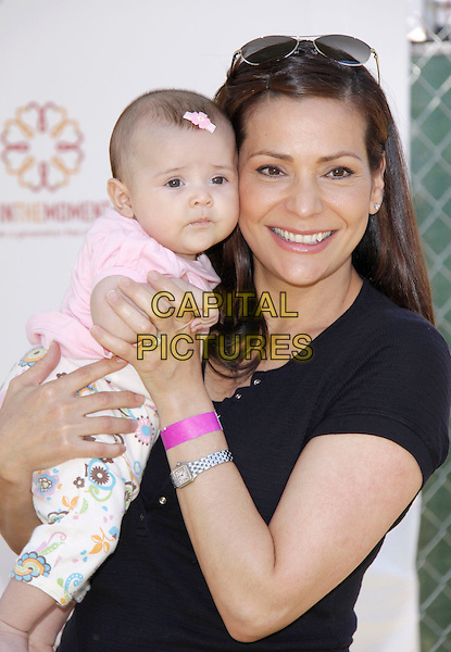 "LUNA MARIE & CONSTANCE MARIE.The 20th annual ""A Time for Heroes"" Celebrity Carnival benefiting Elizabeth Glaser Pediatric AIDS Foundation held at Wadsworth Theater on the Veteran Administration Lawn in West Los Angeles, California, USA. .June 7th, 2009.half length daughter mother mom mum family lifting carrying white pink black top .CAP/DVS                                                  .©Debbie VanStory/Capital Pictures."
