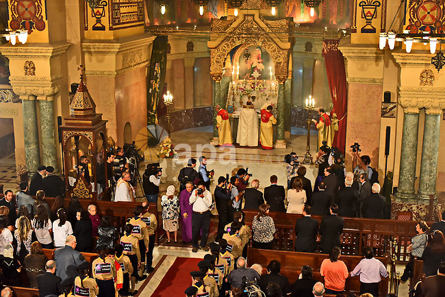 Egyptian Coptic Christians celebrate during a commemorate the 100th anniversary of the 1915 Armenian genocide at the Coptic Orthodox Church in Cairo April 24, 2015.  Historians estimate up to 1.5 million Armenians were killed by Ottoman Turks around the time of World War I, an event widely viewed by genocide scholars as the first genocide of the 20th century. Turkey, however, denies the deaths constituted genocide, saying the toll has been inflated and that those killed were victims of civil war and unrest. Photo by Amr Sayed