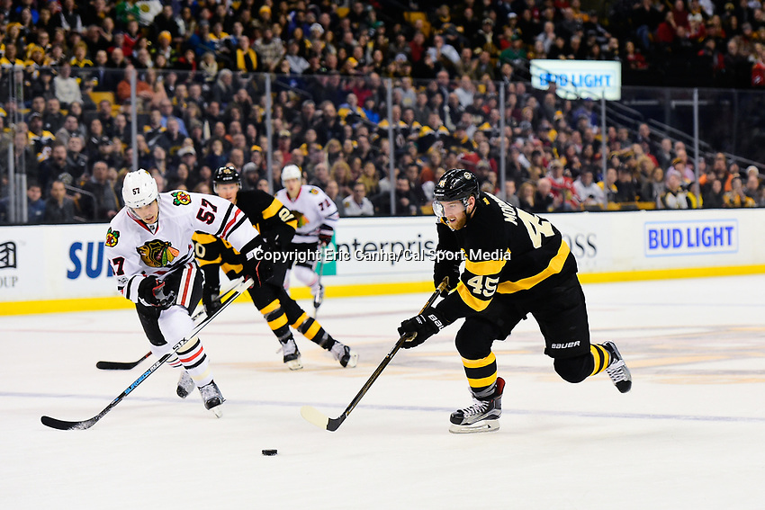 Friday, January 20, 2017: Boston Bruins defenseman Joe Morrow (45) works the puck into the attacking zone during the National Hockey League game between the Chicago Blackhawks and the Boston Bruins held at TD Garden, in Boston, Mass. Chicago defeats Boston 1-0 in regulation time. Eric Canha/CSM